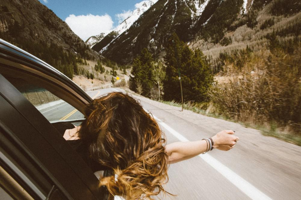 Woman driving in the mountains.