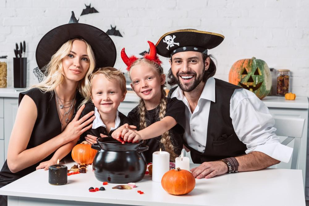 A Family of 4 Enjoying Halloween Treats