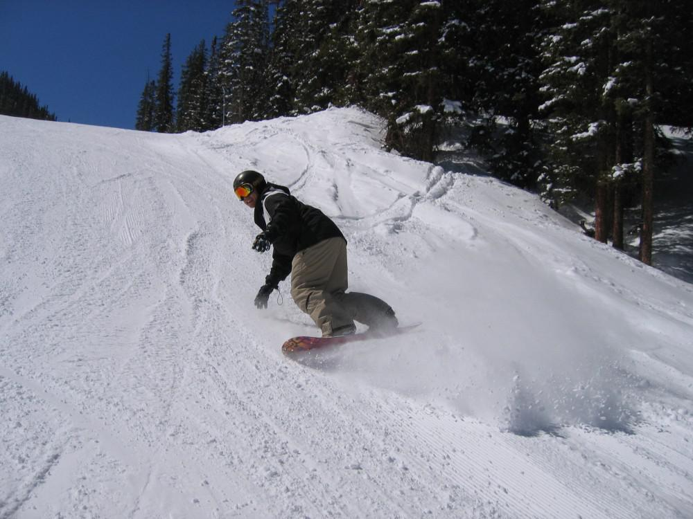 Dr. Chien snowboarding in Crested Butte, Colorado.