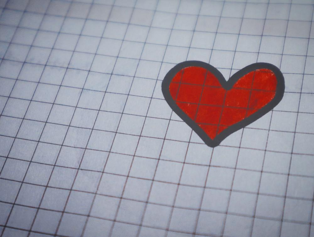red heart drawn on paper