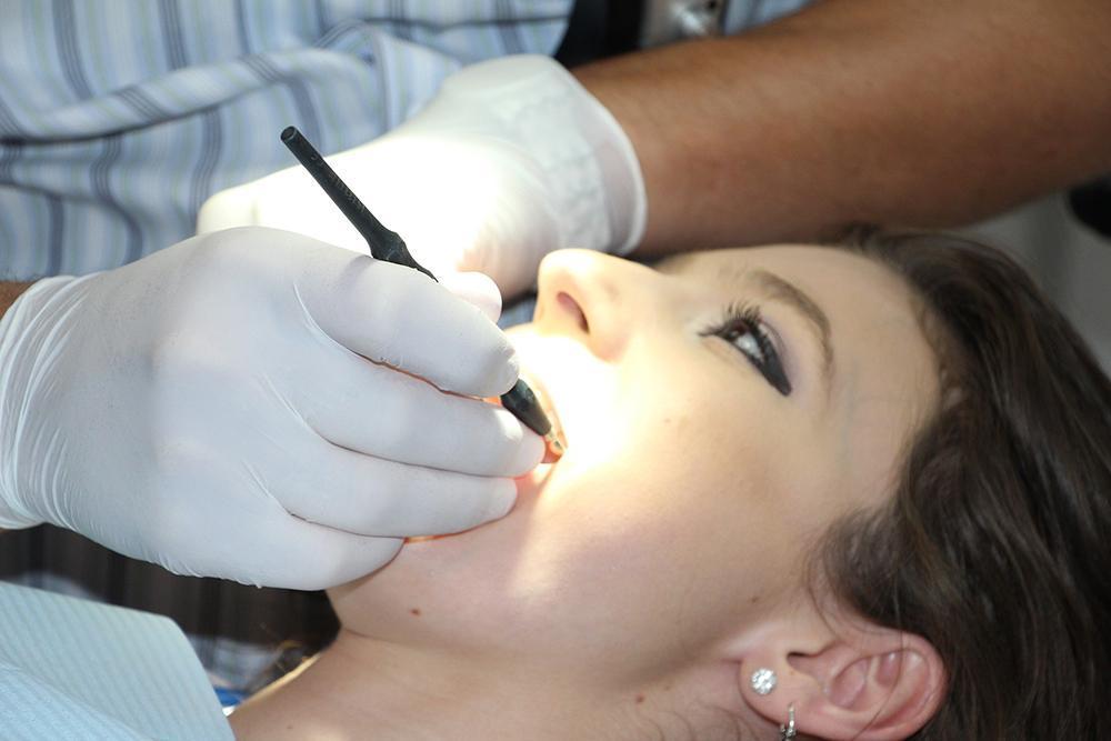 Woman having her teeth worked on