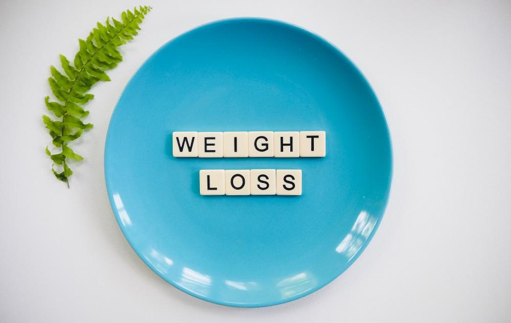 Plate with words WEIGHT LOSS