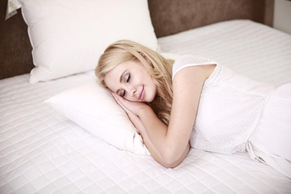 Blonde woman sleeping in bed