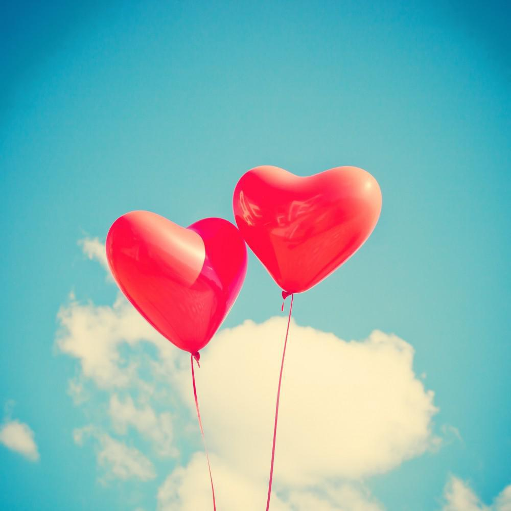 two red heart shaped balloons