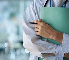 Doctor holding medical record