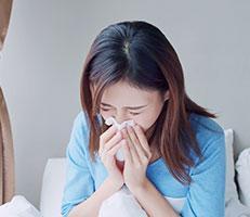 female sneezing