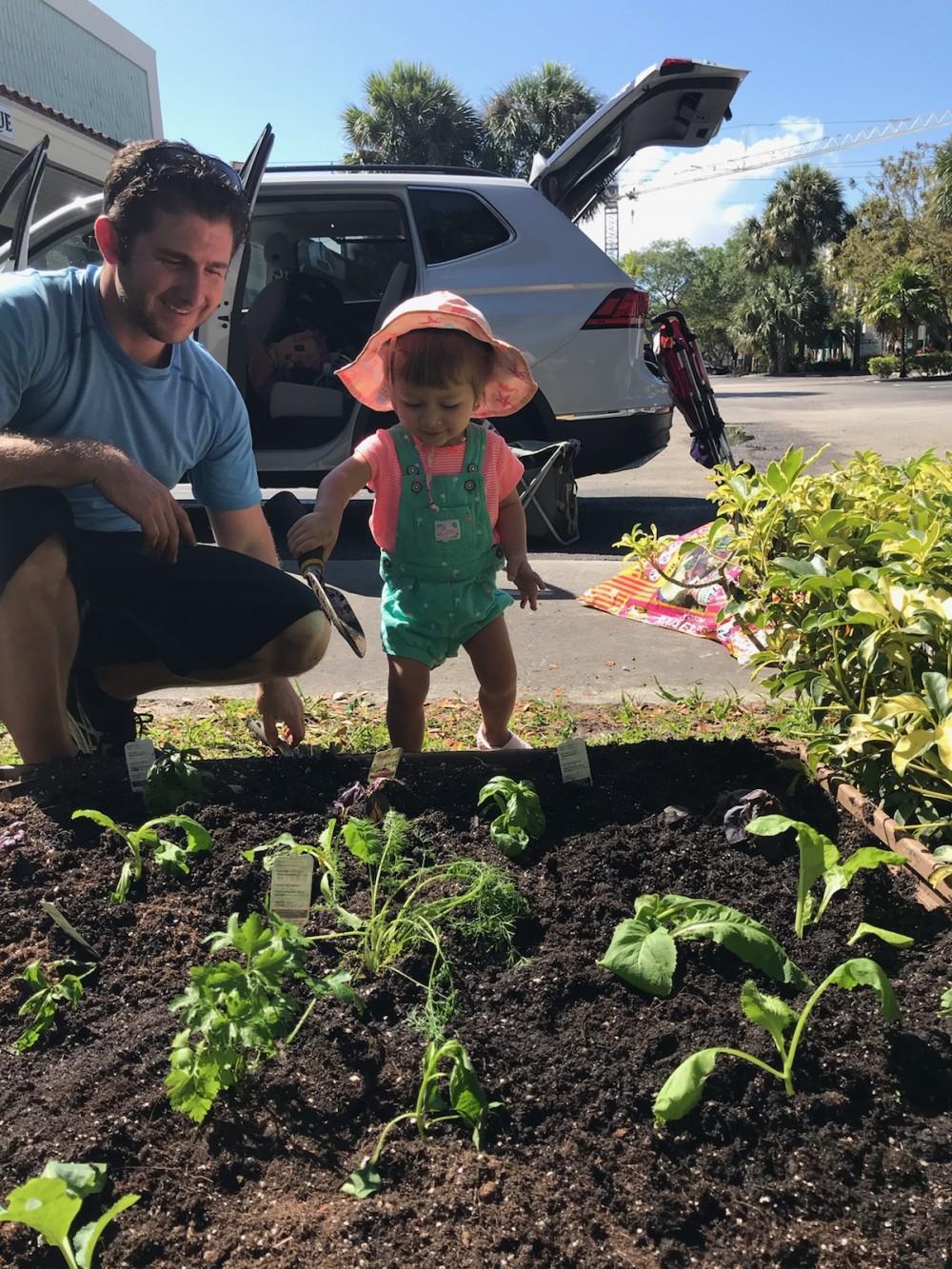 Dr. Elan and his daughter Amelia planting a garden