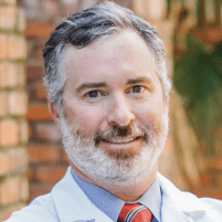 Dr. Justin M. Tenney