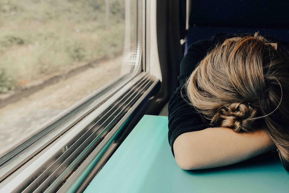 Woman head down on train table