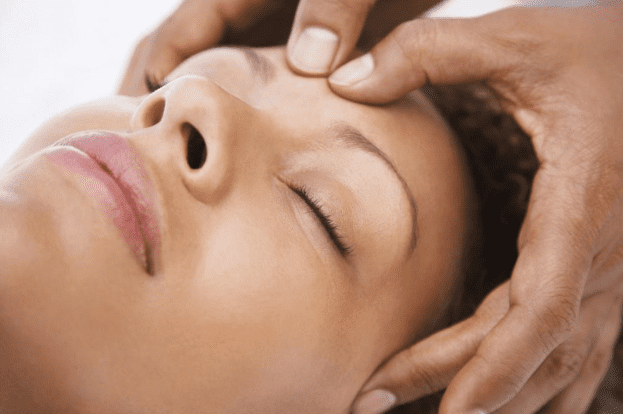 woman getting forehead massaged