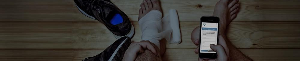 Person with ankle injury looking at phone