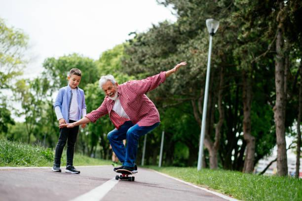 Hip movement on skateboard - young and old man