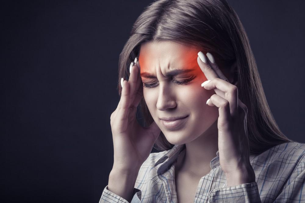 Girl having migraine