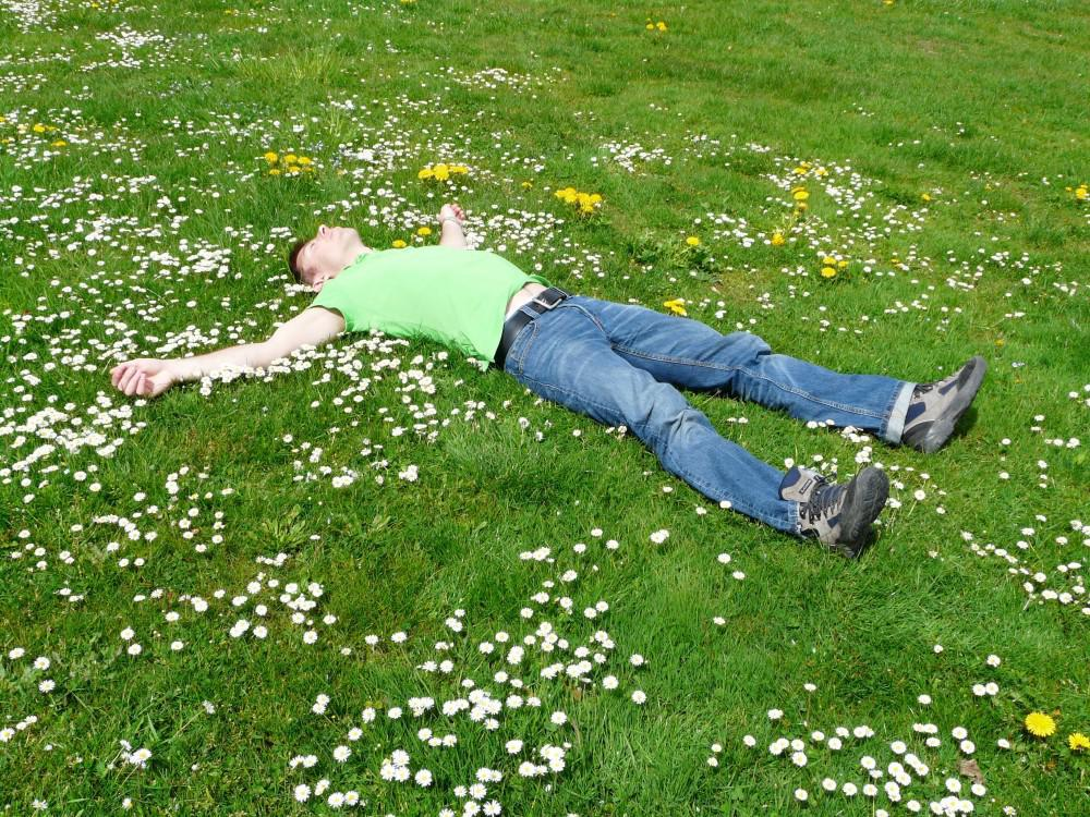 Man laying on green grass