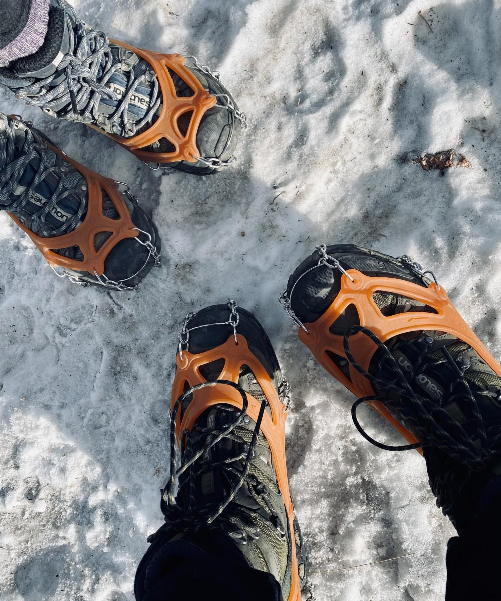 Rigid and high top boots allow for control and stability on hikes. Don't forget the spikes for icy conditions!