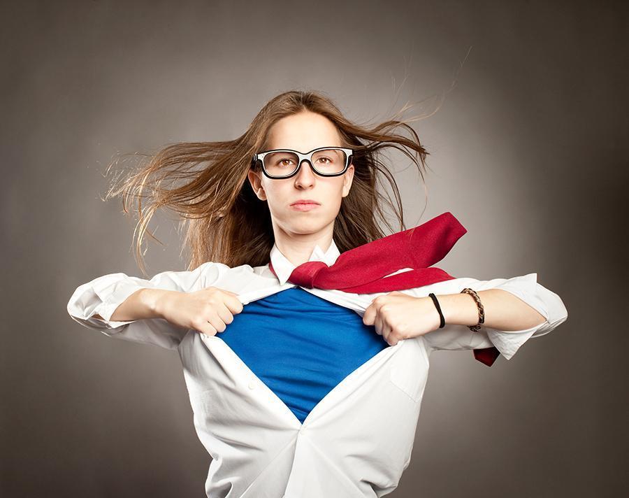 Woman as superhero tearing open shirt like superman
