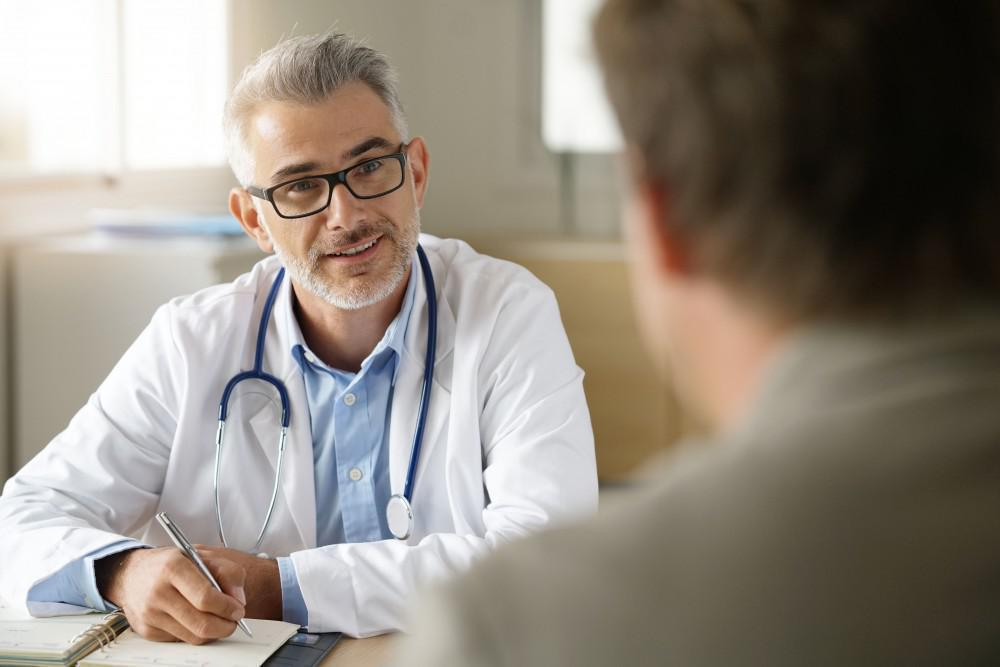 man consulting doctor
