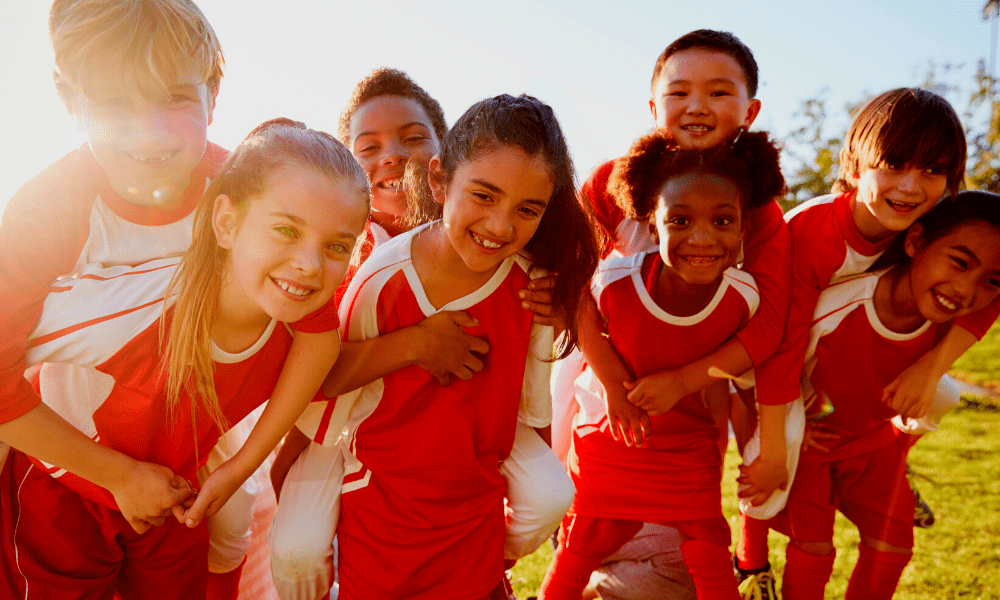 Kids in Soccer Uniforms Posing for a Group Photo