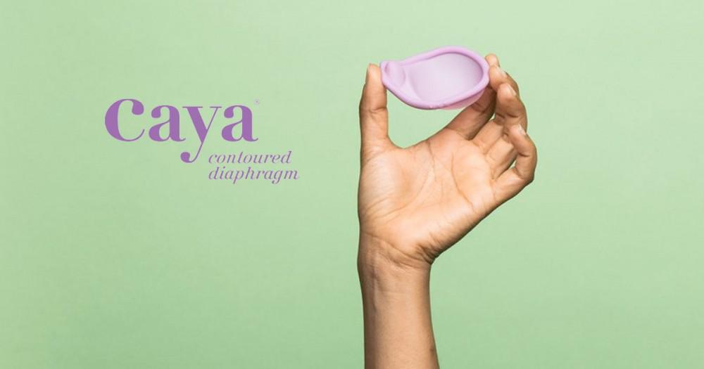 Woman holding the Caya contoured diaphragm