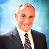 Roger E Schneider, MD