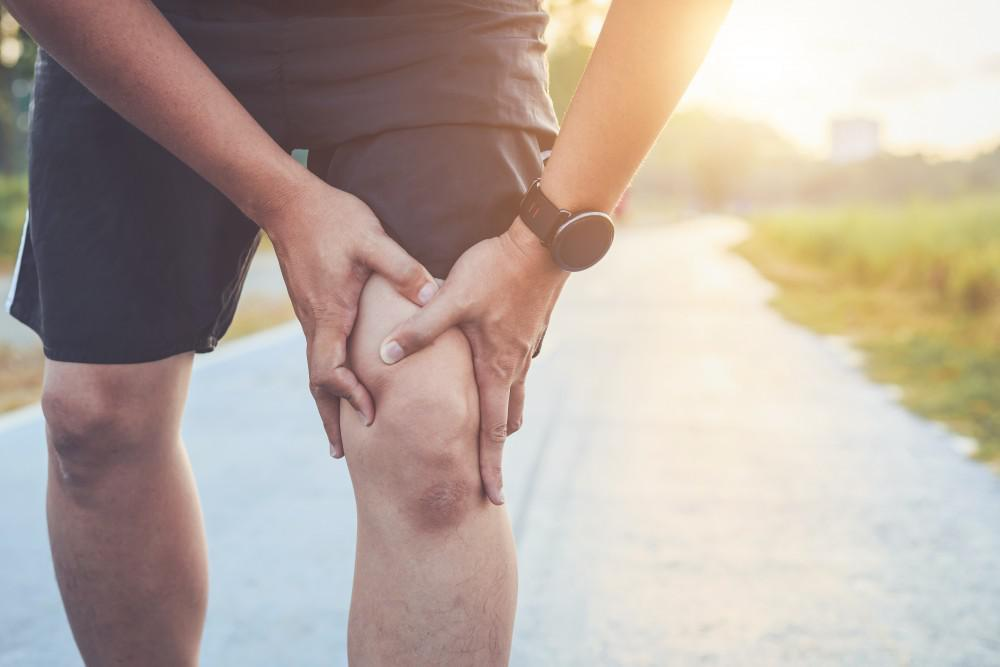 Man in pain from running