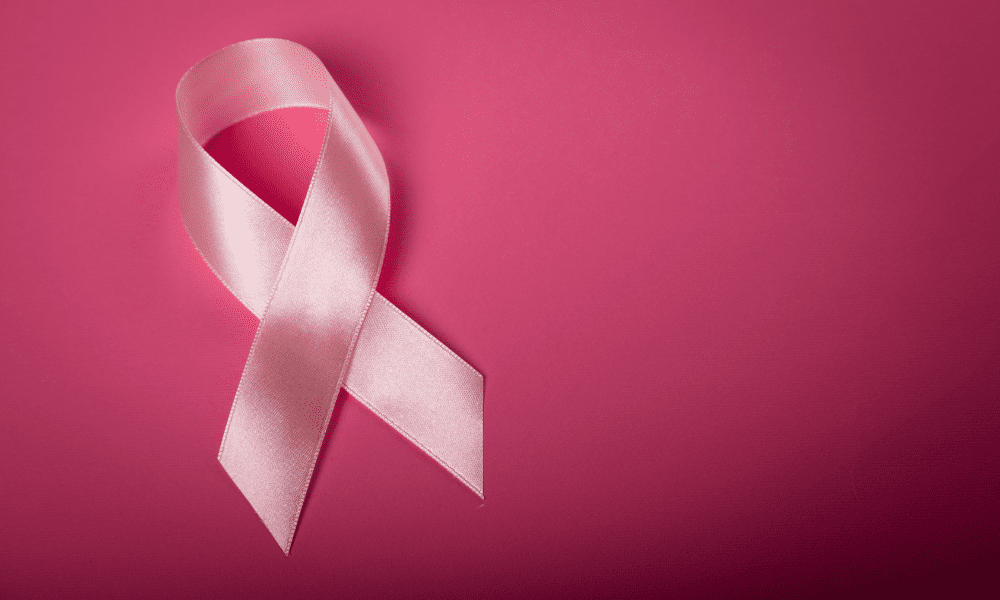 Pink Ribbon Representing battle with Cancer on pink background