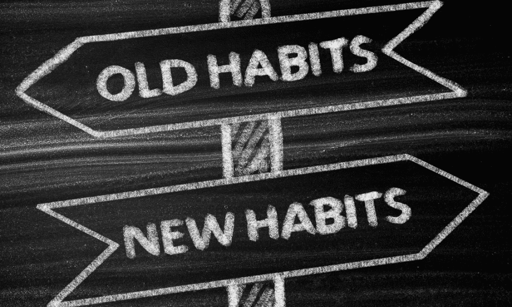"""chalk drawn signs with the words """"Old Habits"""" in an arrow pointing left and """"New Habits"""" in an arrow pointing right"""