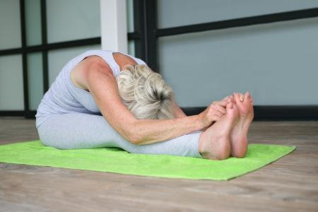 woman exercising with yoga