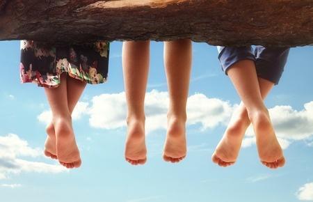 three pairs of bare feet