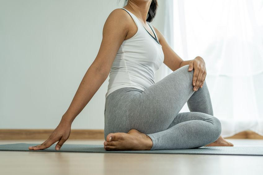 woman on floor practicing yoga