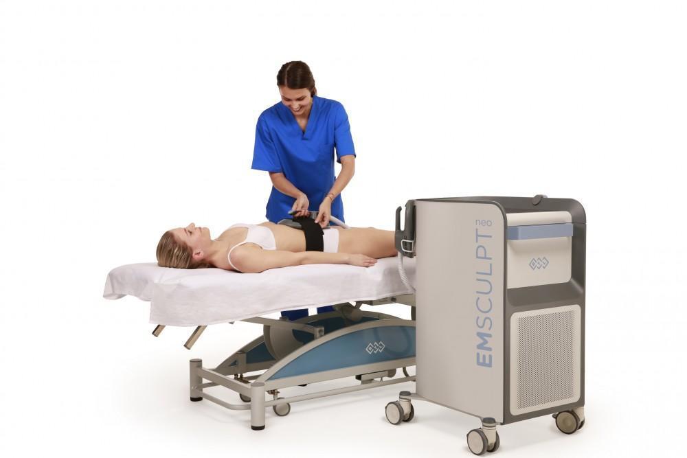 woman starting an EMSCULPT NEO treatment