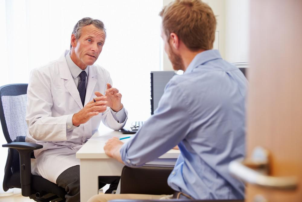 doctor speaking with male patient