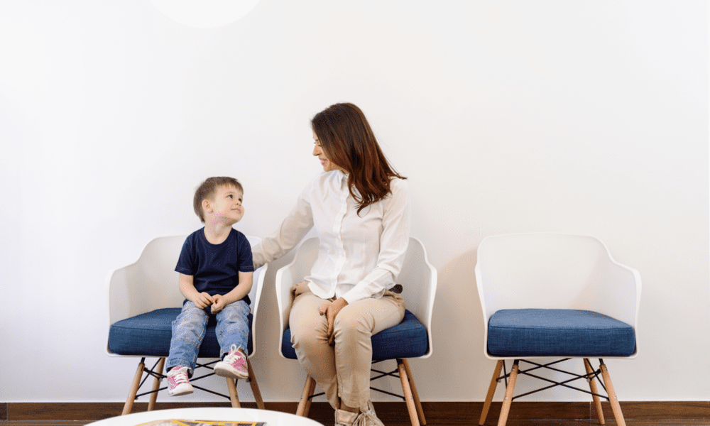 Mother and son in ortho clinic waiting room