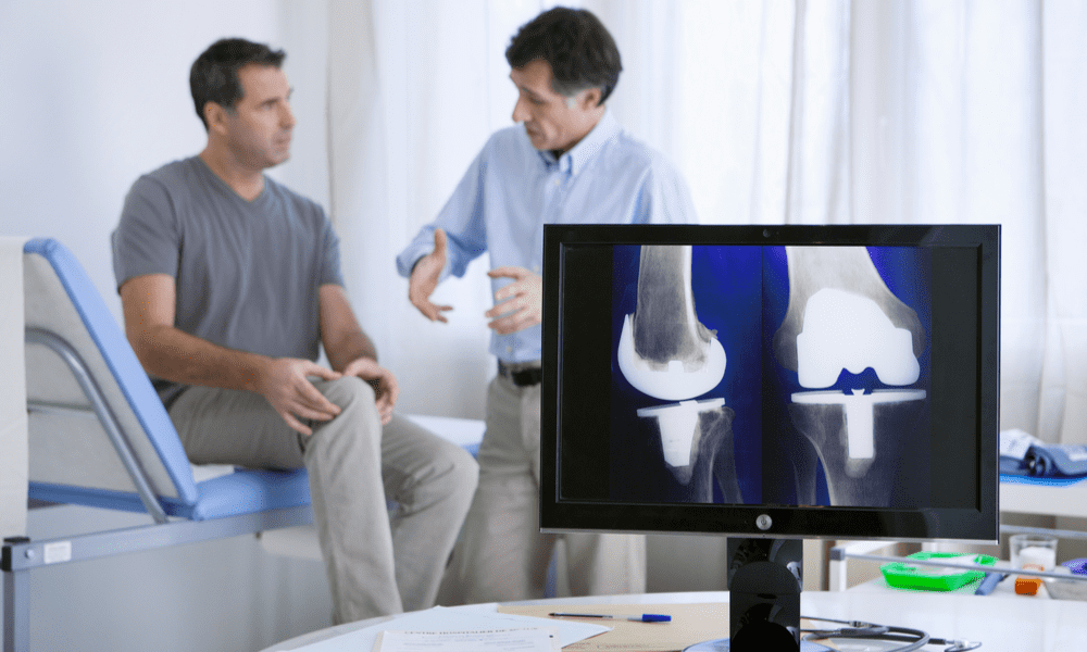 Doctor showing joint replacement x-ray