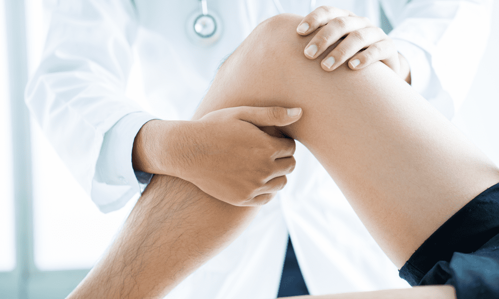 Doctor performing a physical exam on the knee