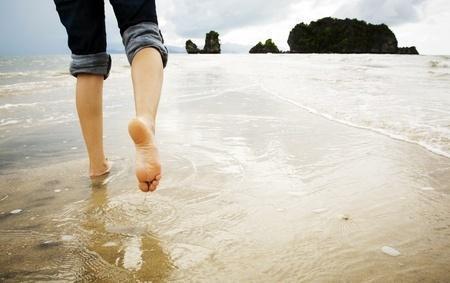barefoot walking on beach