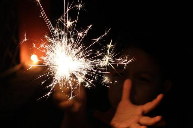 Child playing with sparkler