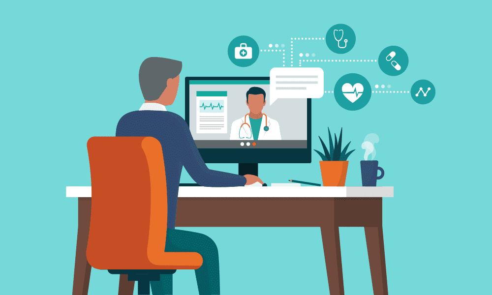 man sitting at computer with doctor on screen