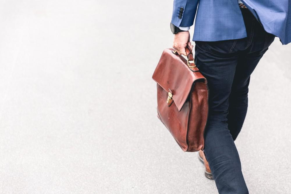 Man walking and holding a briefcase