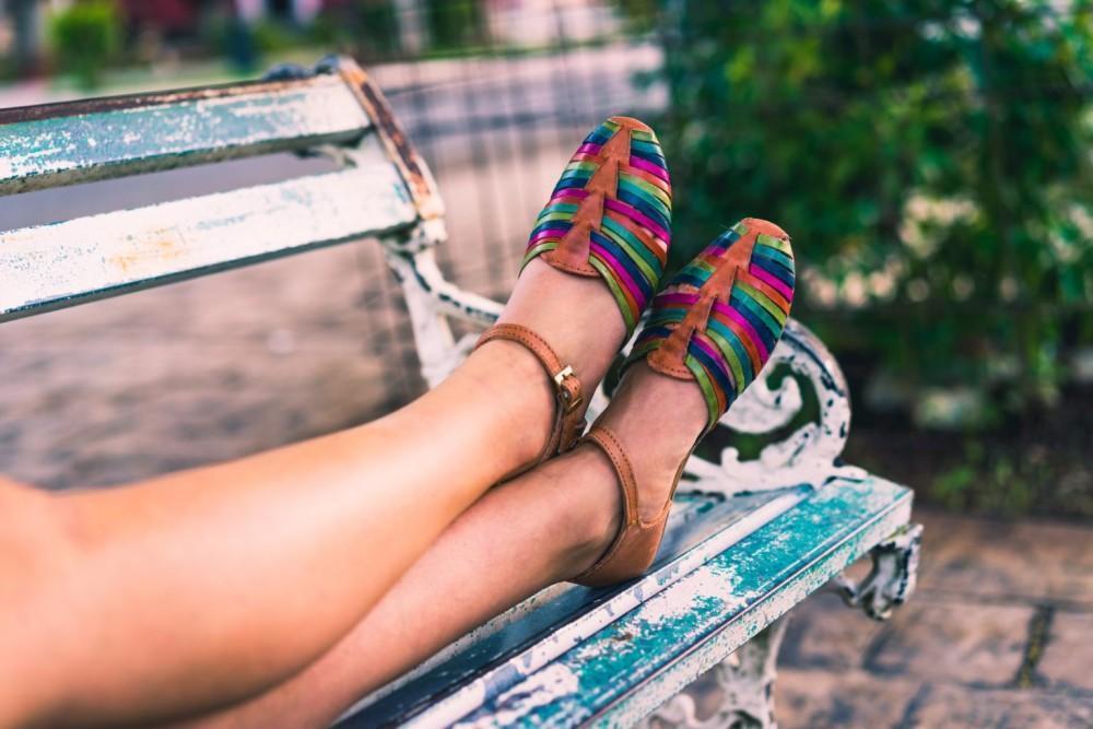Women's feet on a park bench