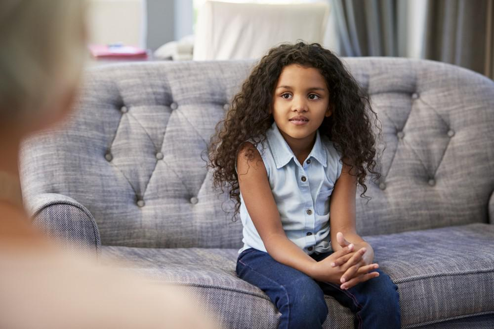 Psychologist-talking-with-child-about-therapy-abuse