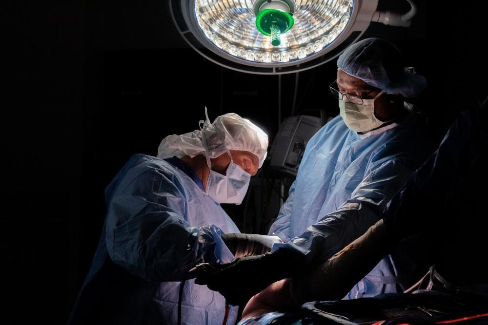 Dr. Burton Elrod performing surgery