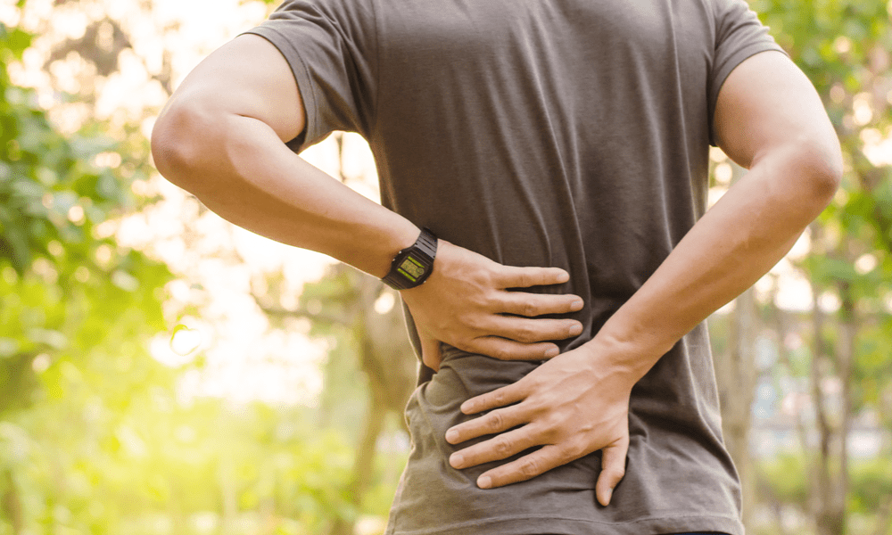 Man with back pain from scoliosis