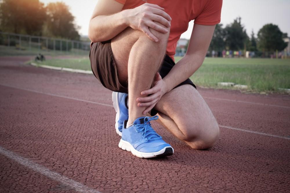 Track Runner Holding Knee