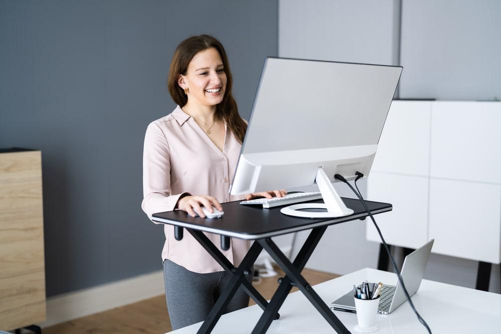 Standing desk converter to prevent back pain