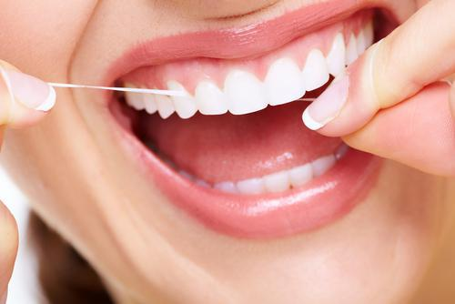 How to Floss Around a Dental Bridge