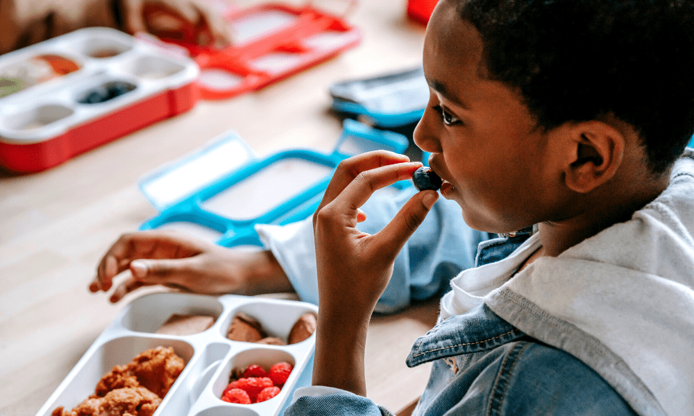 child eating at lunch