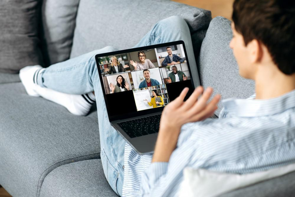 Person sitting on their couch at home on a virtual teleconference call