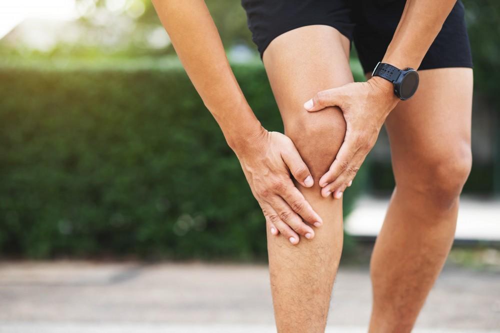 Closeup Of Man Holding Knee, Knee Pain