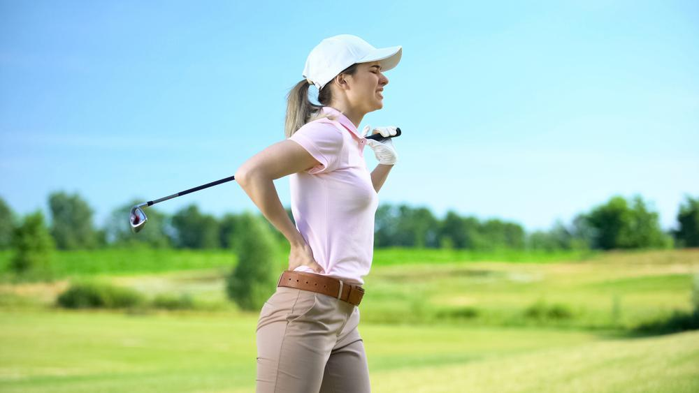 Golfer suffering from back pain